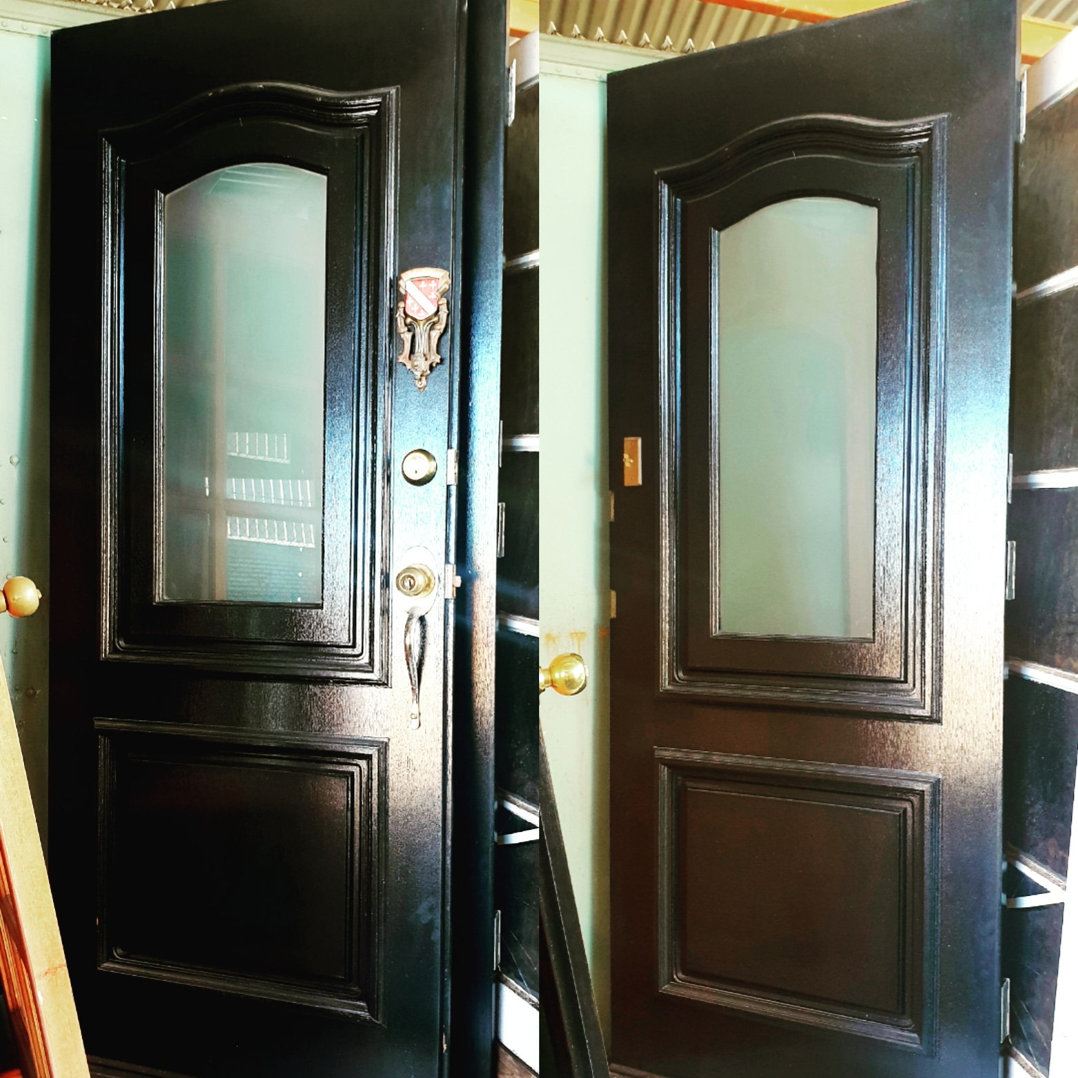 FRENCH PAIR ~ Frosted glass panel in center w/ brass hardware incl. Vintage Door Knocker ~ Black on exterior and timber finish on internal side ~  810w x 2040h/Each $180.00/Pair